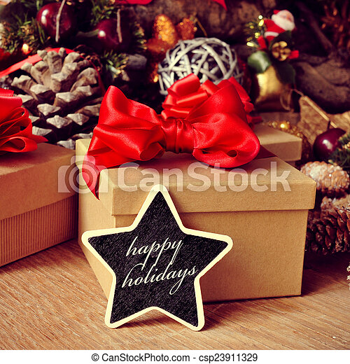 gifts and text happy holidays in a star-shaped chalkboard - csp23911329