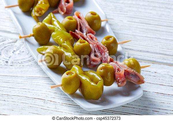 Gilda pinchos with olives and anchovies tapas - csp45372373