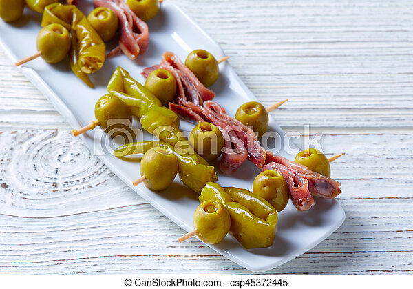 Gilda pinchos with olives and anchovies tapas - csp45372445