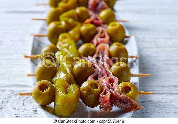 Gilda pinchos with olives and anchovies tapas - csp45372446