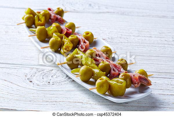 Gilda pinchos with olives and anchovies tapas - csp45372404