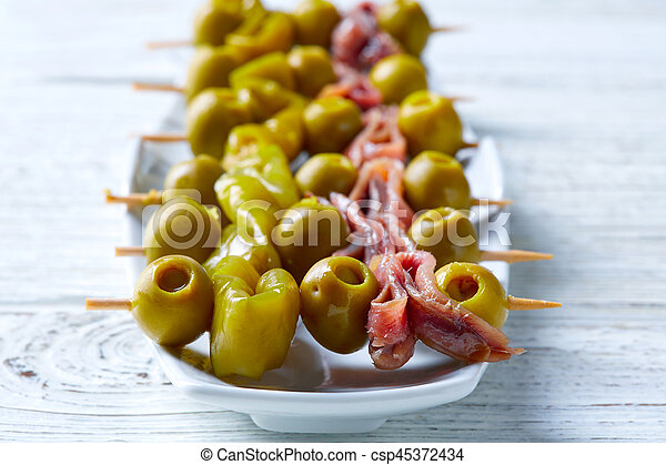 Gilda pinchos with olives and anchovies tapas - csp45372434