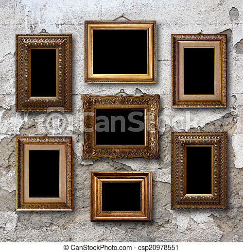 Gilded wooden frames for pictures on old stone wall - csp20978551