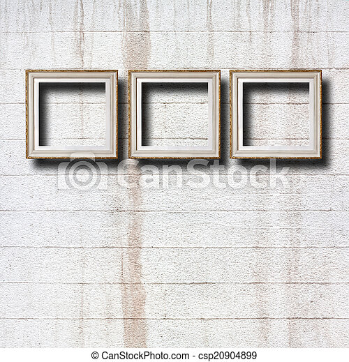 Gilded wooden frames for pictures on old stone wall - csp20904899