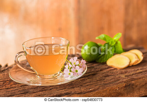 Ginger teacup with green lemon - csp54830773