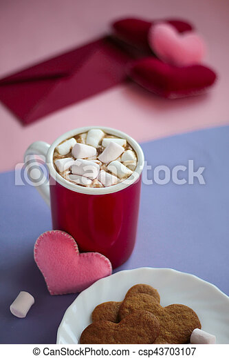 Still life gingerbread cookies, cup of cocoa with marshmallows and felted hearts on dark wooden background Valentines day Celebration top view