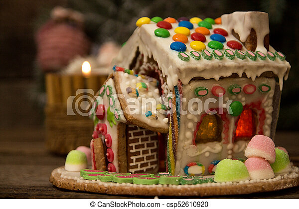 Gingerbread house. Christmas holiday sweets. European Christmas holiday  traditions. Christmas gingerbread house and holiday decorations.
