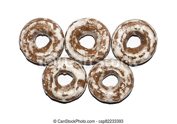 Gingerbread in the form of dries on a white background. - csp82233393