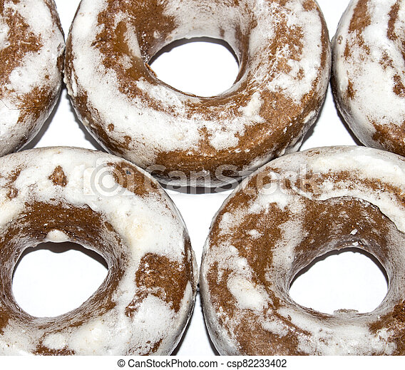 Gingerbread in the form of dries on a white background. - csp82233402