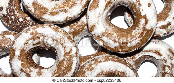 Gingerbread in the form of dries on a white background. - csp82233406