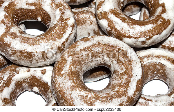 Gingerbread in the form of dries on a white background. - csp82233408