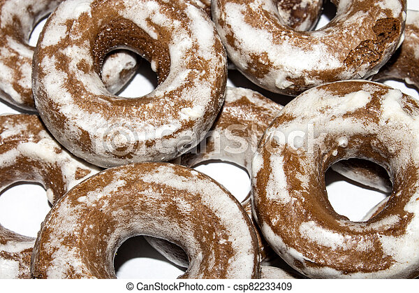 Gingerbread in the form of dries on a white background. - csp82233409