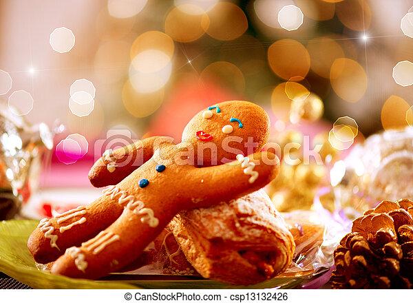 Gingerbread Man. Christmas Holiday Food. Christmas Table Setting  - csp13132426