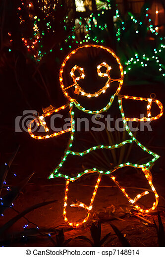 gingerbread man in christmas lights csp7148914