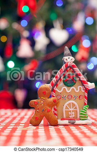 Christmas Gingerbread House Background.Gingerbread Man In Front Of His Candy Ginger House Background The Christmas Tree Lights