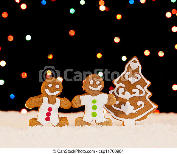 Gingerbread people and christmas tree - csp11700984