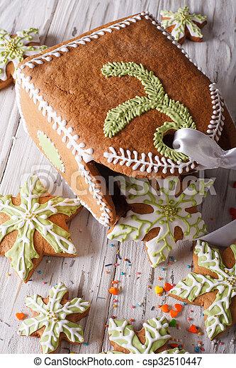 gingerbread snowflake and a bag of cookies close-up. horizontal - csp32510447