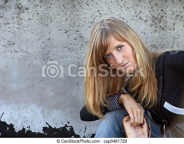 Girl against grunge wall - csp0461729