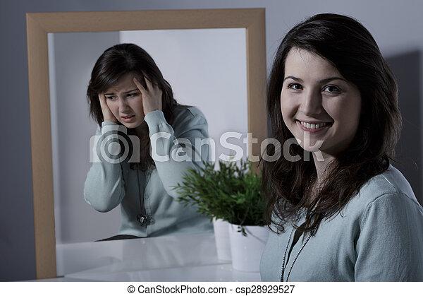 Girl and bipolar disorder - csp28929527