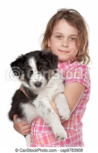 Girl and border collie puppy - csp9783908