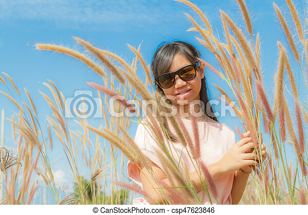 Girl and Feather pennisetum - csp47623846