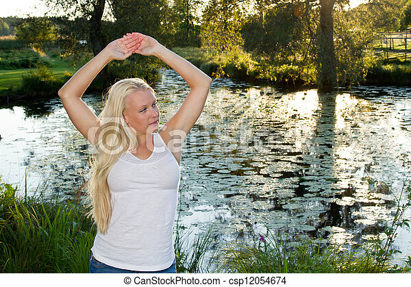 Girl and pond - csp12054674