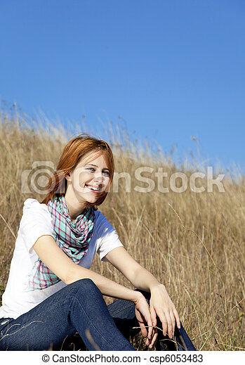 Girl at autumn field. - csp6053483