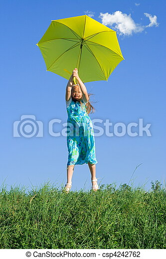 Girl at meadow with umbrella - csp4242762