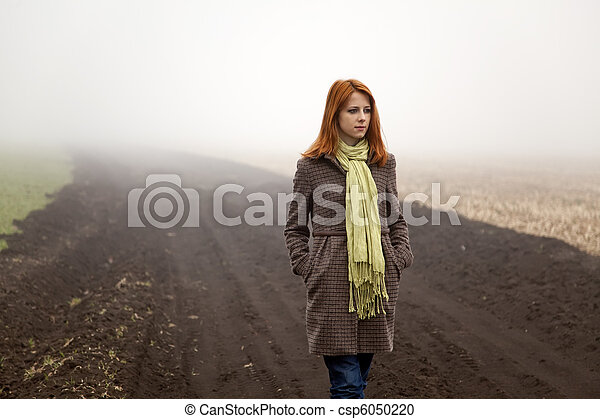 Girl at spring field in fog time. - csp6050220