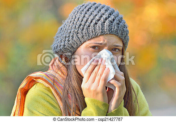 girl blowing nose - csp21427787