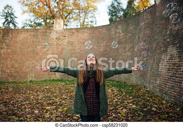 Girl blows balloons. - csp58231020