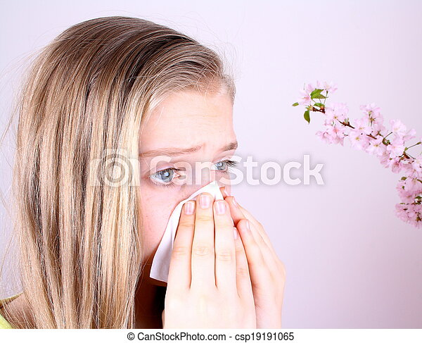 Girl blows her nose with handkerchief and cherry blossoms - csp19191065