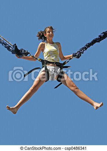 Girl bungee jumping - csp0486341