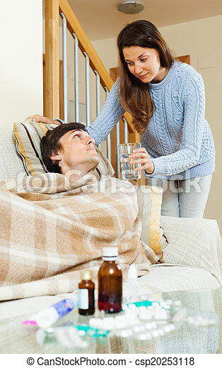 girl caring for sick husband - csp20253118
