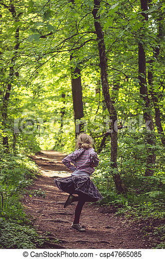 girl dancing in spring forest - csp47665085