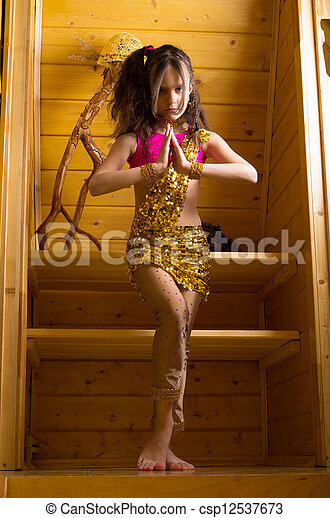 girl dancing indian dance in wooden house - csp12537673