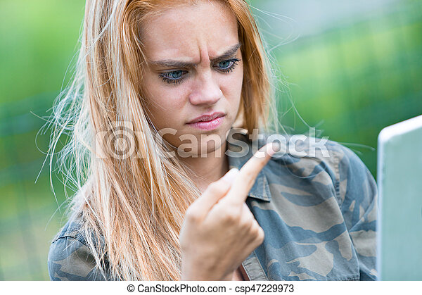 girl disgusted by something on her finger - csp47229973