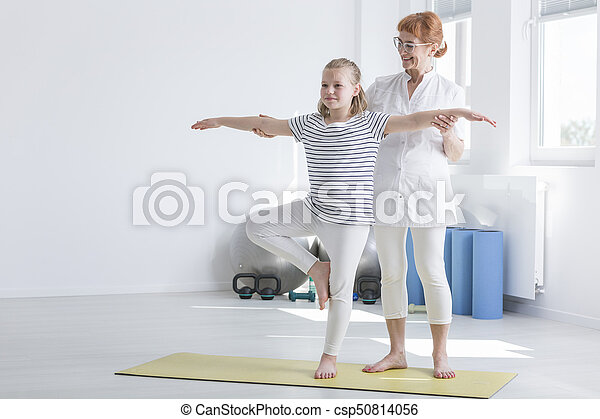 girl doing exercise improving posture blonde girl stands