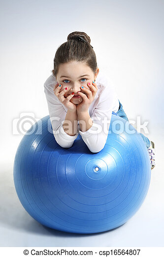 girl doing exercises with a rubber  - csp16564807