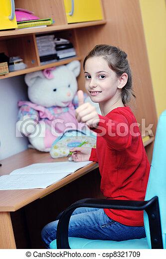 girl doing homework - csp8321709