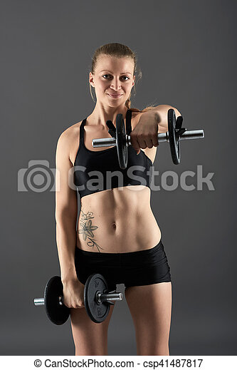Girl Doing Shoulder Workout With Dumbbells