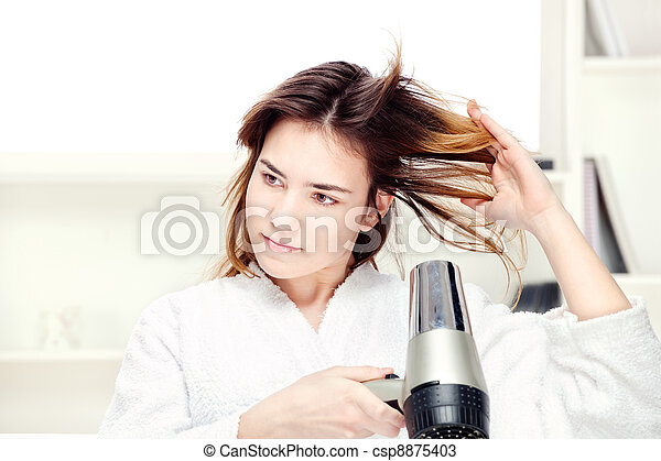 girl drying her hair at home - csp8875403