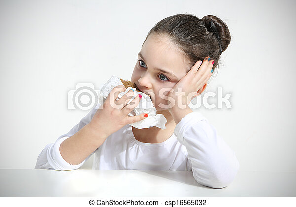 girl eating a sandwich - csp16565032