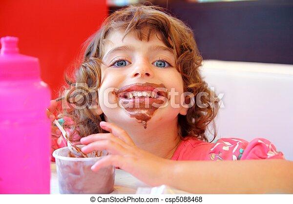 Girl eating chocolate ice cream dirty face - csp5088468