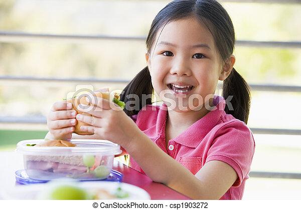 Girl eating lunch at kindergarten  - csp1903272