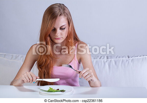 Girl eating very small lunch - csp22361186