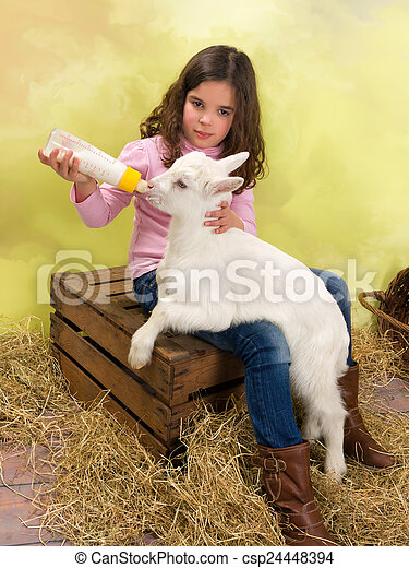 Girl feeding baby goat - csp24448394