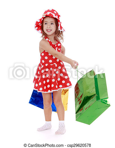 71fcf5478ac Girl goes shopping. Beautiful little girl in a short red summer ...