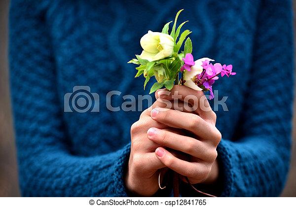 girl hand giving flowers - csp12841765