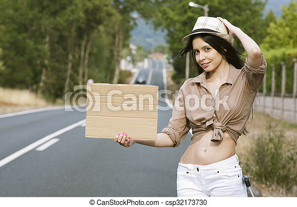 girl hitchhiking on the road - csp32173730